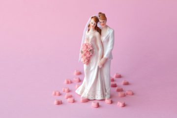 wedding cake topper with two women