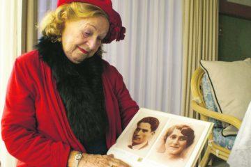Ruth Rack looking at photos