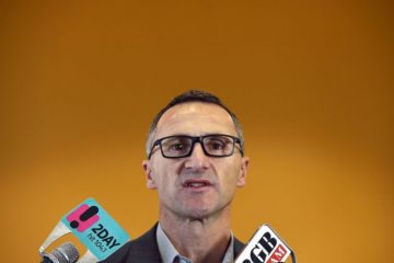 Richard Di Natale at a press conference