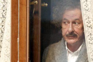 Geoffrey Rush as Einstein peeking out a window