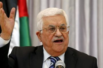 Abbas speaking at a microphone, close up