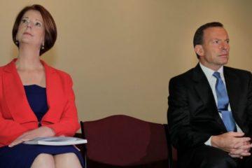 Abbott and Gillard sitting awkwardly near each other
