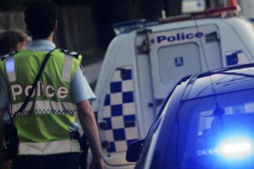 police walking near police vehicle