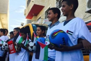 Palestinian kids with soccer stuff