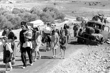 refugees walking along a road