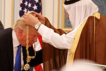 Trump bowing, having medal placed round his neck by Saudi King