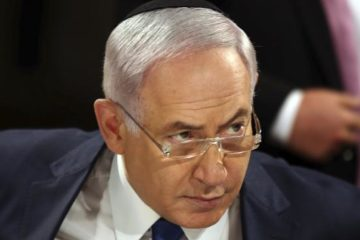 Bibi looking sternly over his glasses