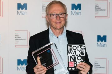 David Grossman holding his book and his award