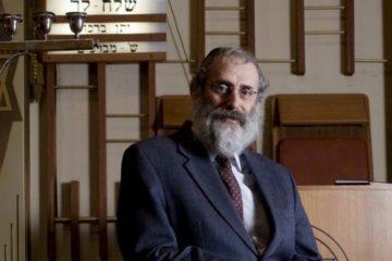 Rabbi Milecki posed looking at camera