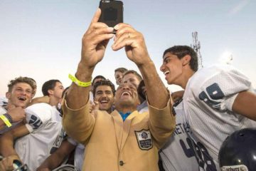 israeli kids standing around the nfl player taking a selfie