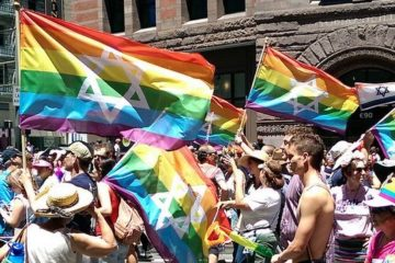 the jewish pride flag being waved at a rally