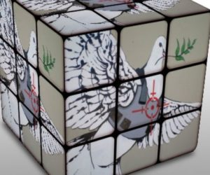 rubik's cube with peace dove in crosshairs