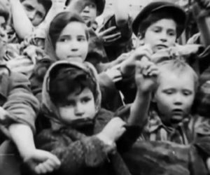 children being liberated from a camp all displaying their number tattoos