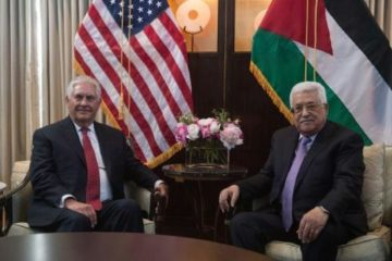 Tillerson and Abbas sitting in front of their respective flags