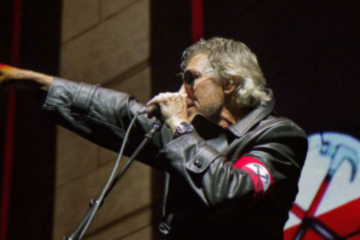 Waters on stage in 2013 in a nazi-like uniform