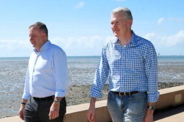 Albanese and Burke walking along beach