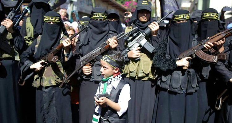 Armed Palestinian with small boy with toy gun in front of them