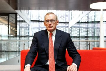 Bob Carr posing on chair
