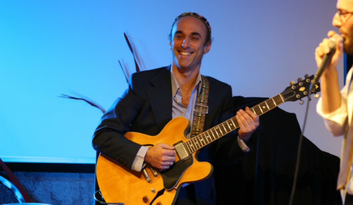 smiling guy with guitar
