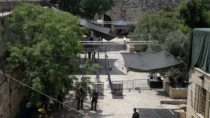aerial view of old city area where israeli police are standing near cameras