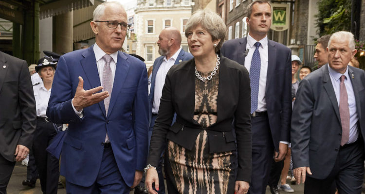 Turnbull and May walking in Borough market