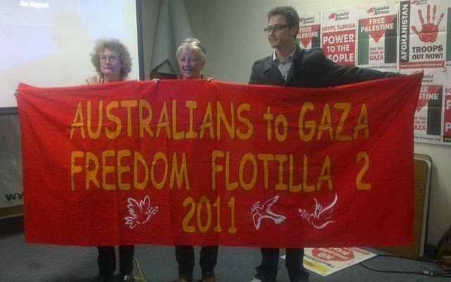 Vivienne and two others holding freedom flotilla sign