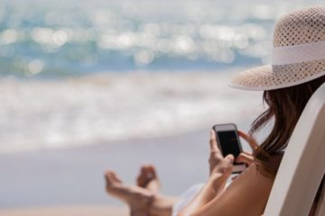 woman on phone at beach
