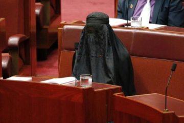 Pauline Hanson sitting in the Senate underneath a burqa