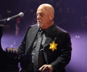 Billy Joel at piano with a yellow star of david on his chest