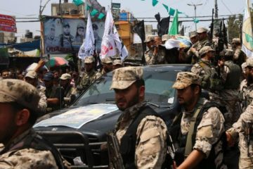 hamas militants in funeral procession