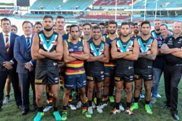 Port and Crows players posing for indigenous round