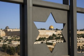 view of dome of the rock through a star of david gate