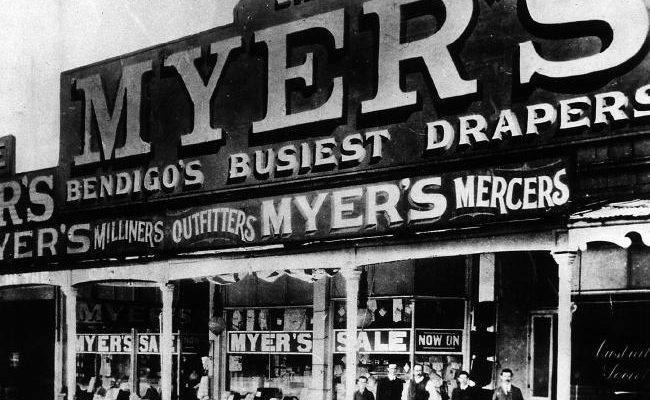 Myers deparment store front in 1910 with myer and others standing in front