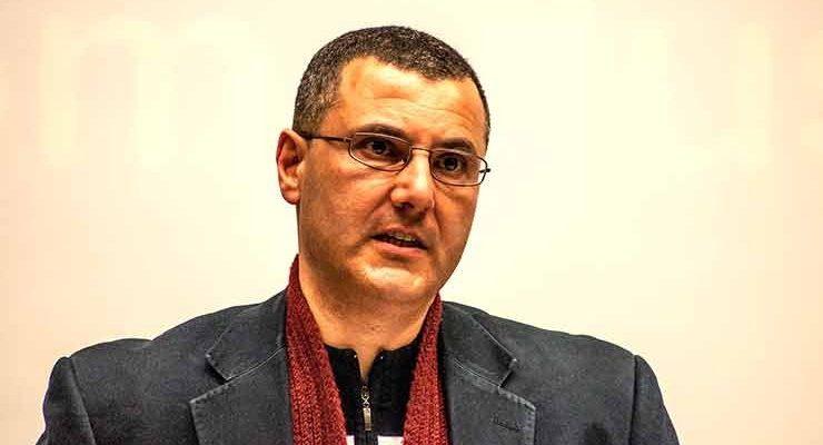 Omar founder of BDS, headshot, being interviewed.