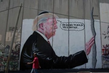 mural of trump touching the kotel and saying he will build another wall, drawn on the west bank separation wall