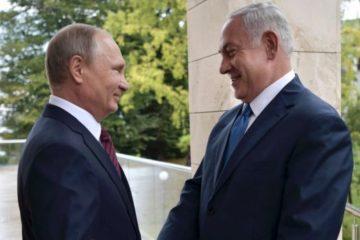 Vladimir and Bibi shaking hands happily
