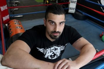 avi posing in boxing ring