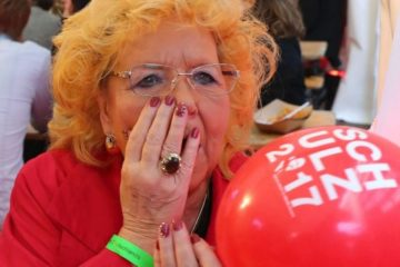 lady with hand over her mouth in shock at the election results