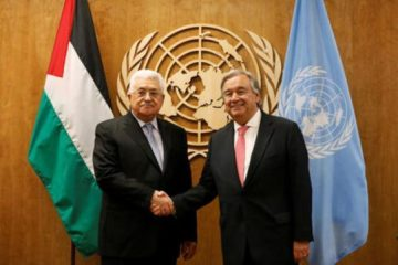 abbas shaking hands with someone at the UN