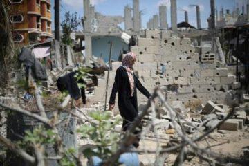 woman walking in rubble