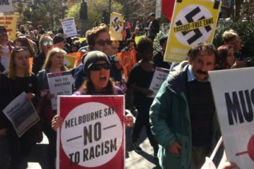 protesters with signs in melbourne