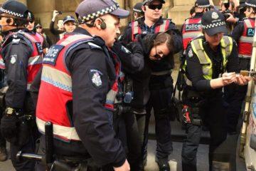 police arresting protester