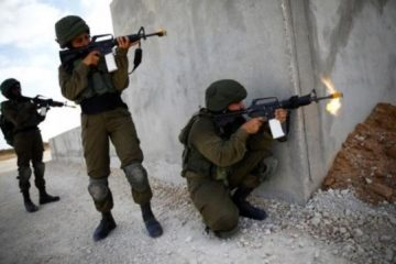 3 soldiers doing a military exercise