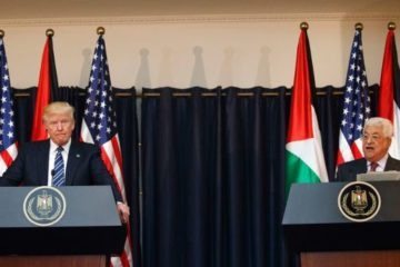 Trump and Abbas at podiums with flags behind them