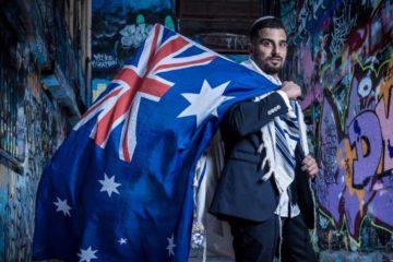 avi draped in a tallit and australian flag