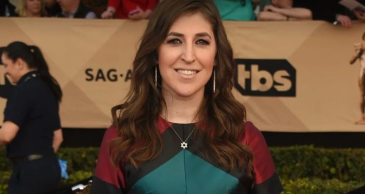 mayim posing outside an event