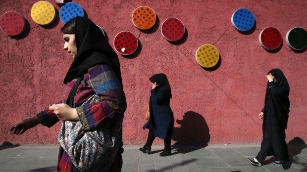 two women walking down the street in teheran