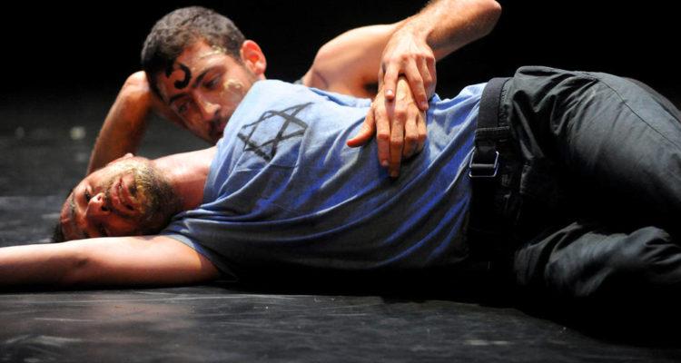 scene from play. two men lying on floor