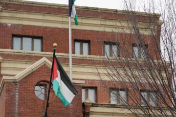 exterior of office with Palestinian flag flying
