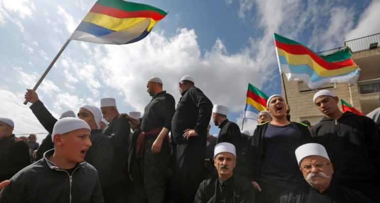 Druze men protesting, flying flags